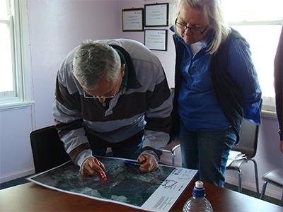 Steve and Sarah Palmer examining the aerial map of their property